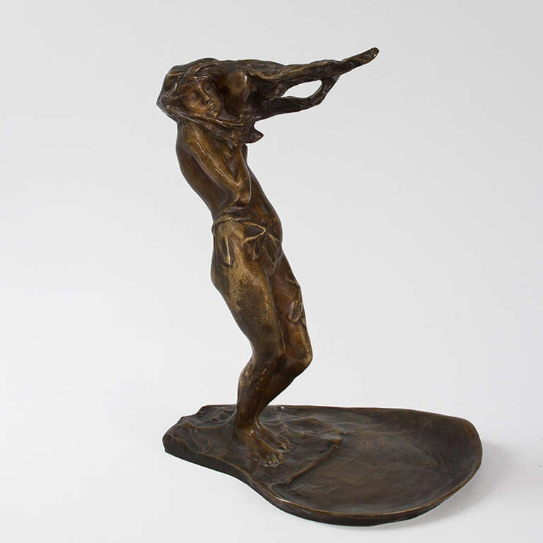 A German Art Nouveau patinated bronze figural vide poche by Bernhard Hoetger featuring a windblown nude with vines, circa 1910. Pictured in: Dynamic Beauty: Sculpture of Art Nouveau Paris, by Macklowe Gallery, The Studley Press, 2011, p.