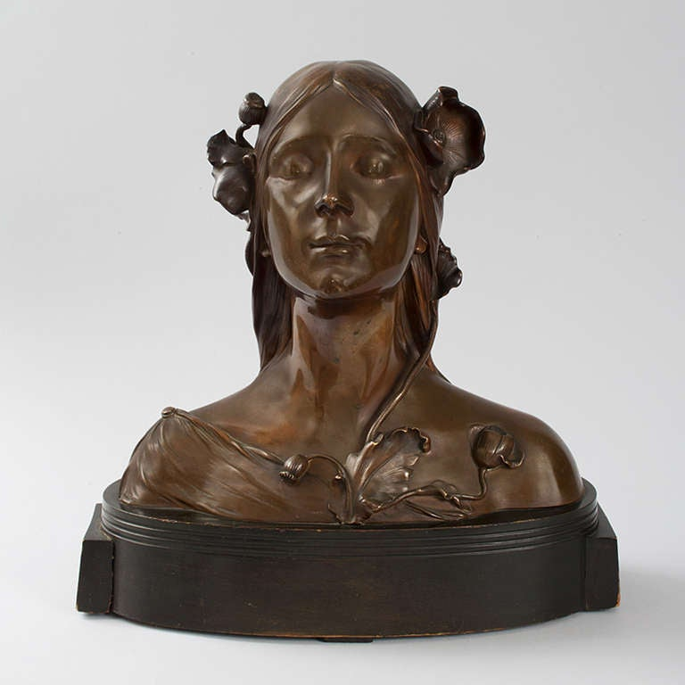 Austrian Art Nouveau patinated bronze bust of Ophelia by Josef O¨fner. Like the sculpture of Maurice Bouval, O¨fner depicts Ophelia as a sleeping woman adorned with flowers. The sculpture rests on a painted wood base. Signed,