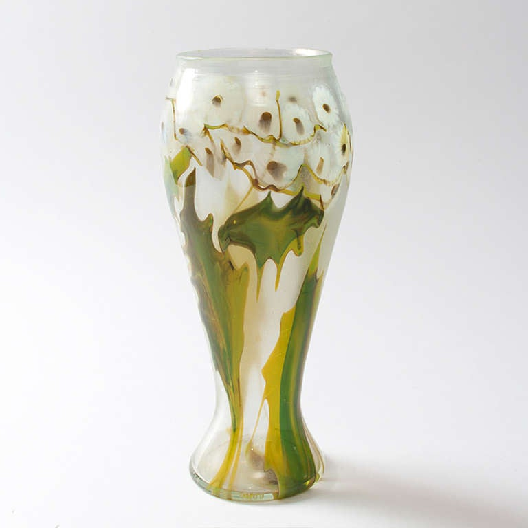 """A Tiffany Studios New York favrile glass """"paperweight"""" vase, depicting a band of white daisies with green leaves, circa 1900.   The paperweight technique involved fusing thin rods of transparent glass in a variety of colors. The resulting thicker"""