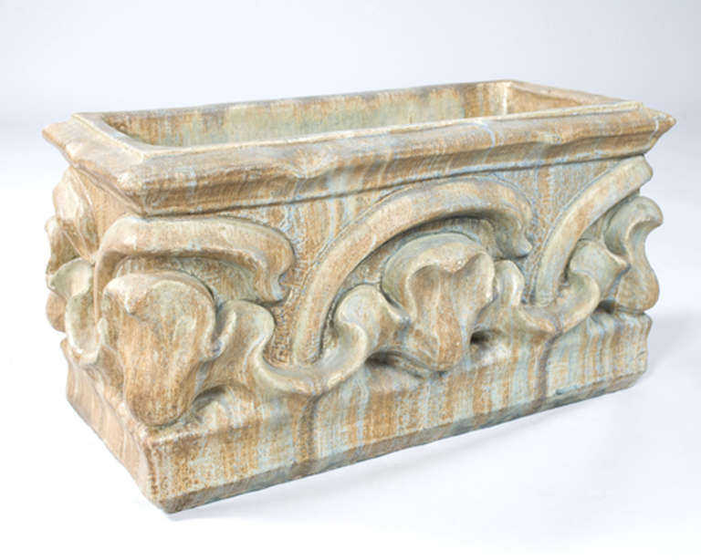 A French Art Nouveau earthenware window box/planter by Alexander Bigot for the architect Cintrat, featuring an organic pattern that repeats itself around the base. Circa 1898.   (MG #10910)