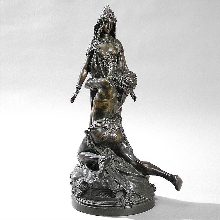 A French Art Nouveau patinated bronze sculpture by Théodore Rivière, featuring two intricately-sculpted figures from the story of Carthage. The woman has emerald eyes and her crown is accented with rubies, circa 1900.  The subject of this figural