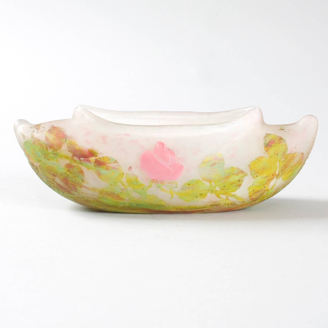 """A French Art Nouveau cameo glass boat-form vase by Daum, featuring an applied wheel-carved pink flowers and etched green leaves. This small, delicate vase has an unusual shape.  Circa 1900.  Signed, """"Daum Nancy"""" with the Croix de Lorraine.   A"""