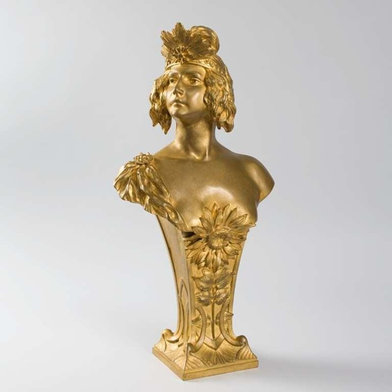 A French Art Nouveau gilt bronze bust of a woman by Louis Chalon.