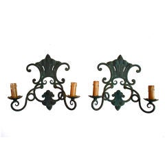 A pair of antique French wrought iron sconces