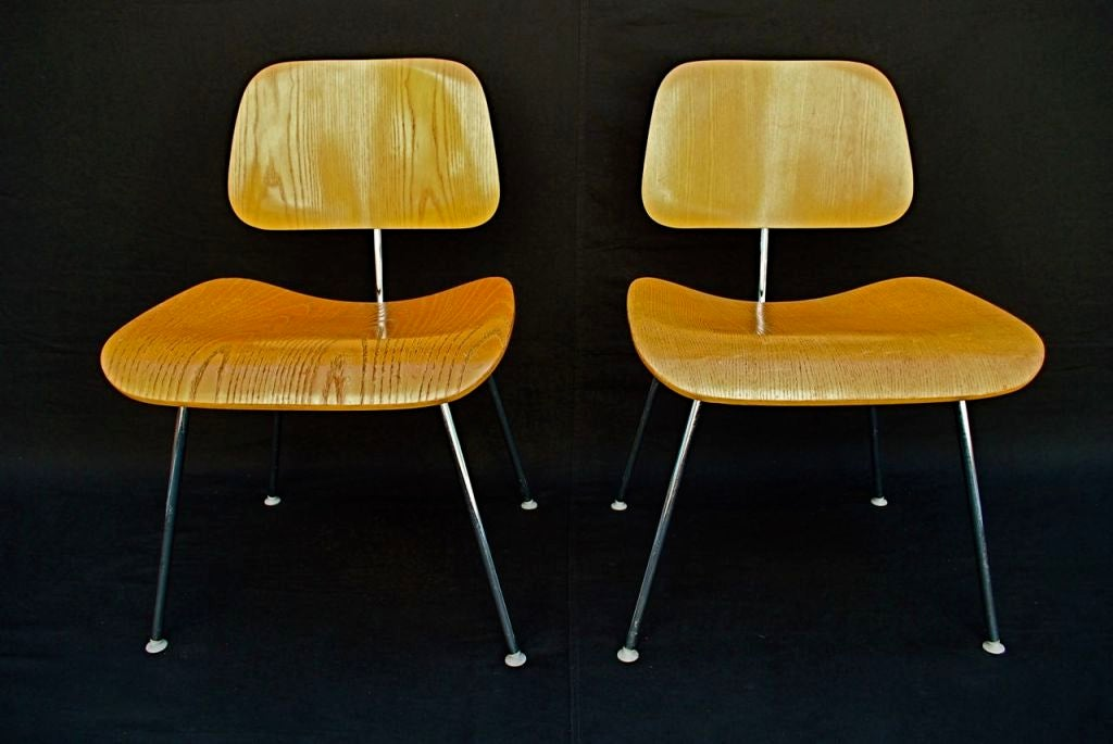 pair of dcm chairs by charles eames for herman miller for sale at