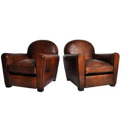 Pair of Round Back Leather Chairs