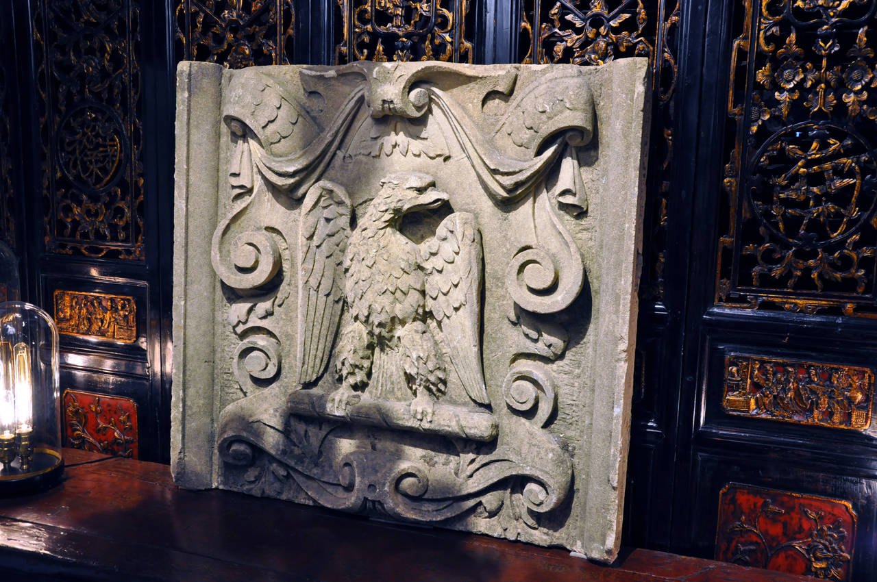 The plaque depicts a crest with a French Imperial Eagle which was used by the Grande Armée of Napoleon I during the Napoleonic Wars. The fragment was likely salvaged from a government building.