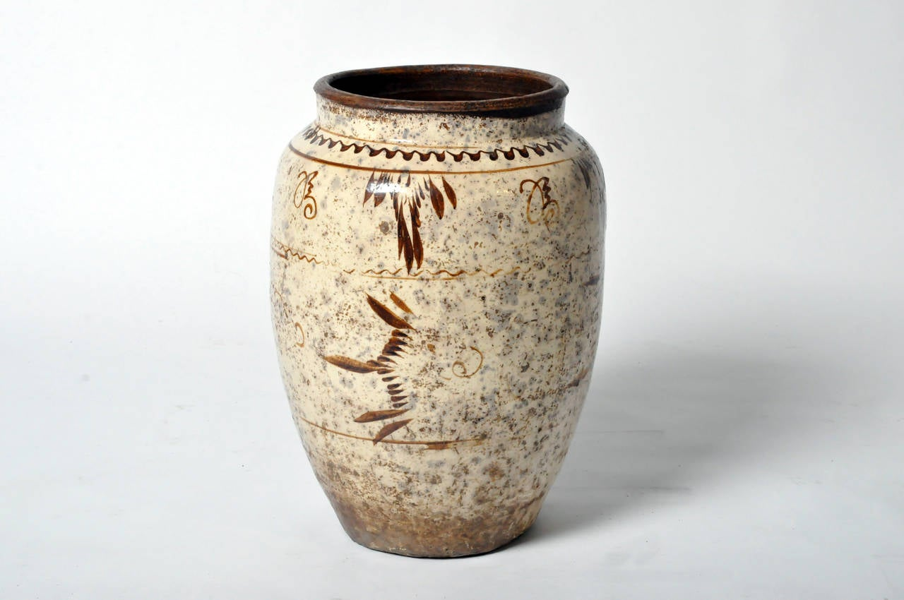 This ceramic vase is from Shanxi, China early 1900's. It features hand painted decorations and has a beautiful aged patina.