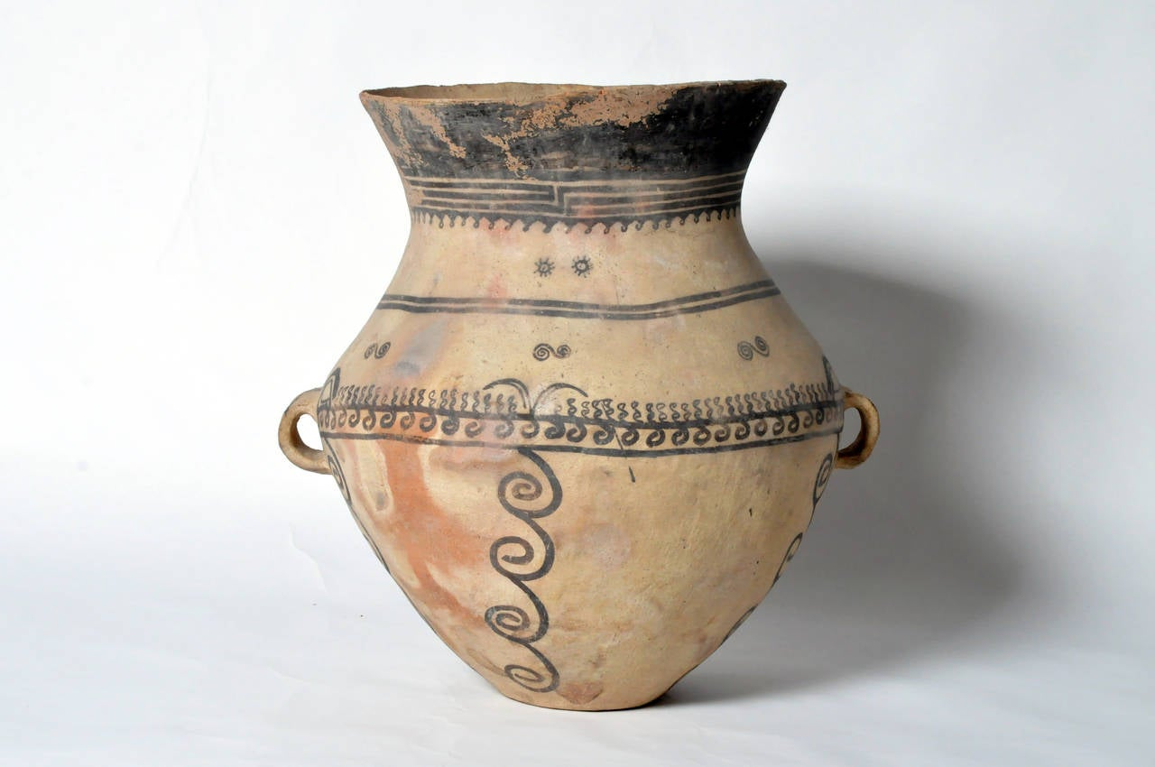 This pot most likely came from what is now modern Kansu, the corridor west of the Yellow River and in the T'ao River Valley region of northwest China and east Mongolia. The Hsia Chia Tien culture (1890-1100 BC) that resided here actually predates