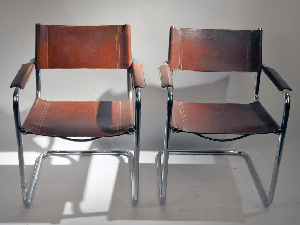 pair of leather chairs armchairs with tubular metal frame