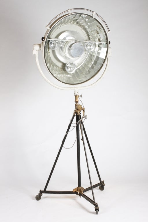 This impressive French surgical lamp dates to the 1950s and is in exceptional working order. It has been rewired to accommodate less powerful lights. The central lamp is focus-able. The entire lamp housing can be raised or lowered by use of the