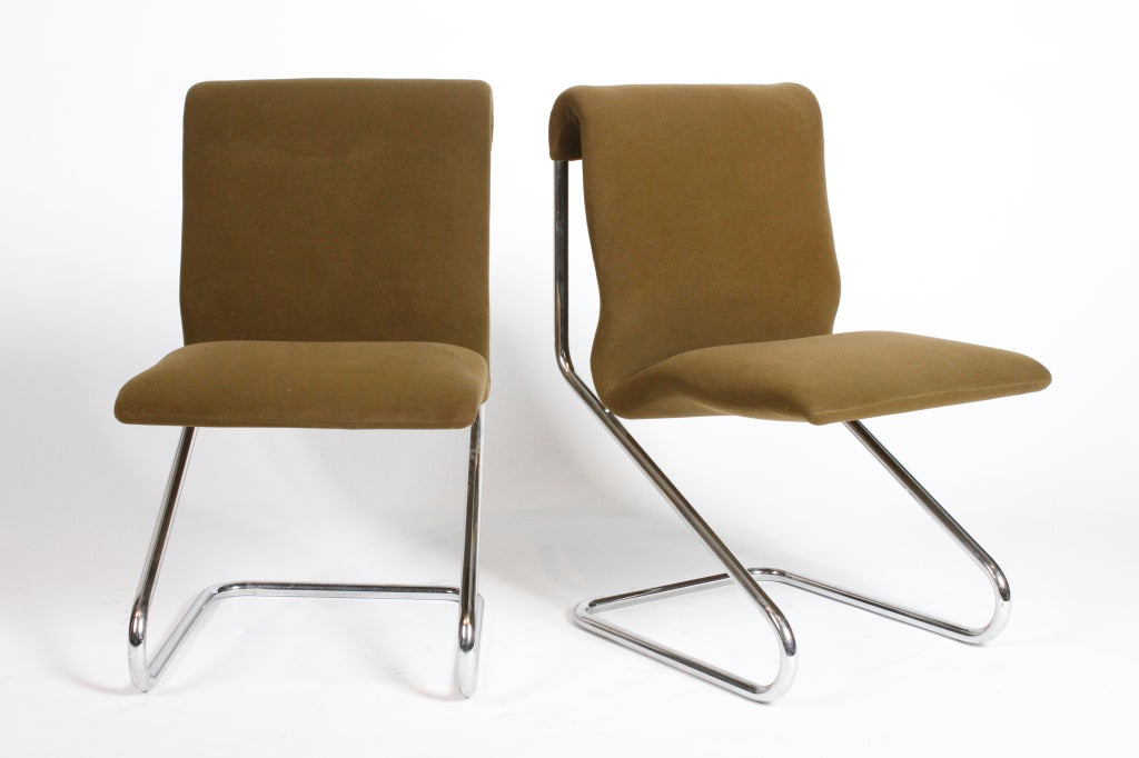 This pair of 1970's French armless chairs is made of tubular chrome with moss green upholstery.