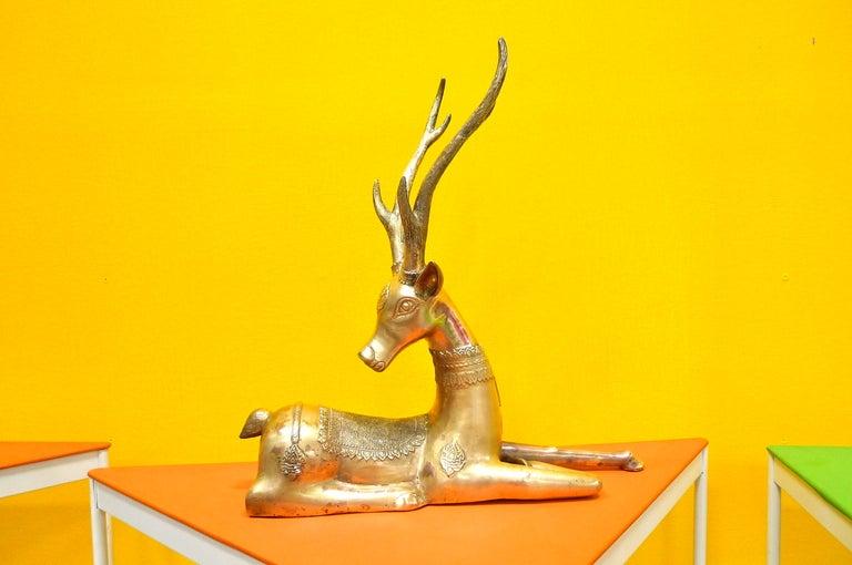 Intricately detailed pair of heavy brass figures of resting deer by Sarreid