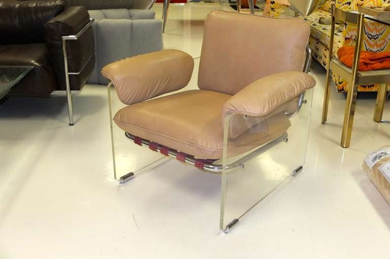 Classic lounge chair from Pace Collection with slab lucite sides on chromed steel sliders and tubular chromed steel frame with leather straps.
