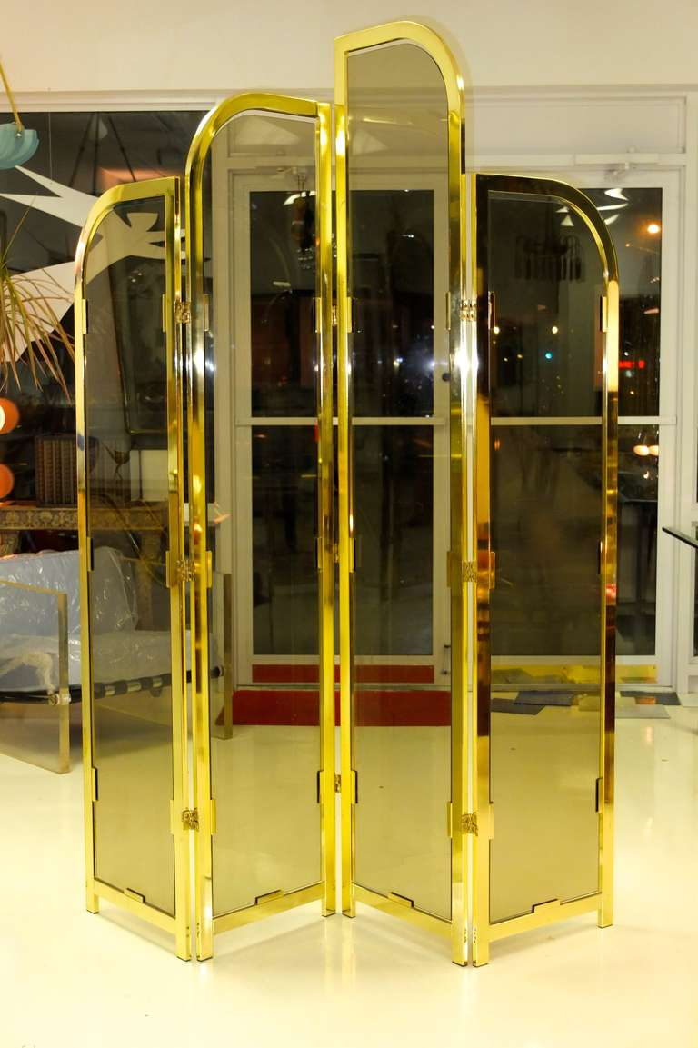 SATURDAY SALE  Spectacular vintage 4 panel folding floor screen, each panel of staggered height with curved art deco style gold plated frame and smoked glass inserts. Attributed to DIA Design Institute America.  What a way to transform any room