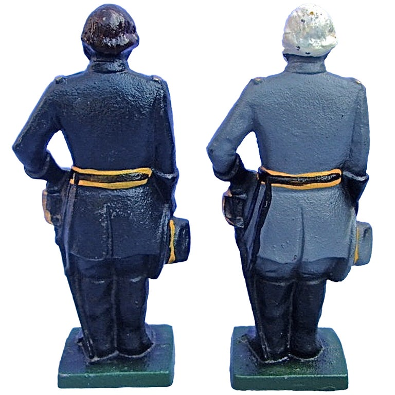Pair Of Vintage Cast Iron Door Stops Or Bookends For Sale