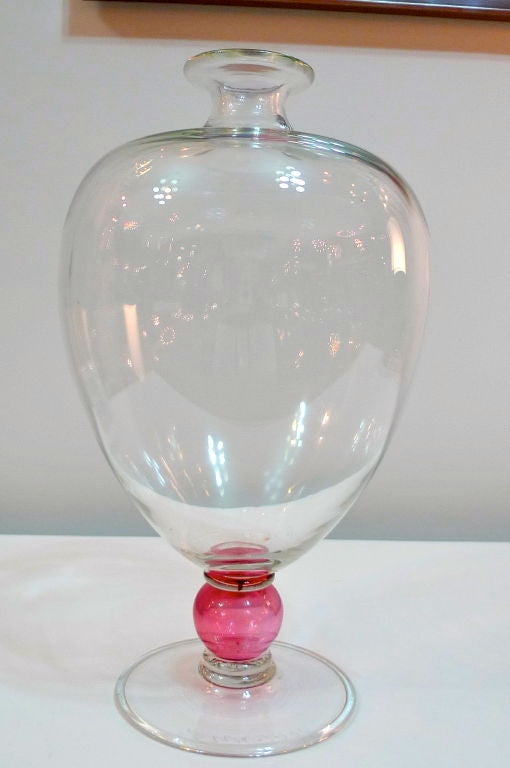 Large mouth-blown 'Veronese' vase with a fuschia colored glass ball stem, signed by the artist and dated 1990.  Signature illegible. <br /> <br /> After the 1921 design of the same name by Vittoria Zecchin for Cappelin Venini & Co., the Murano