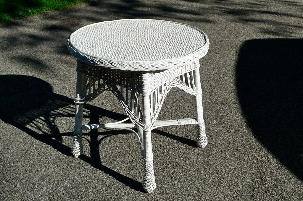 Timeless antique white wicker round table