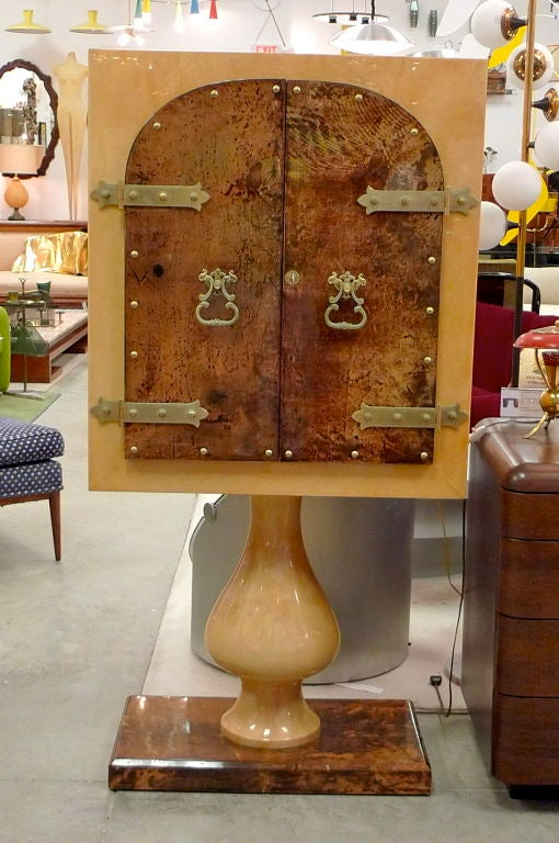 SATURDAY SALE   Late 1950's/early 1960's Italian standing bar cabinet with double doors by the 'Maestro of Parchment', Aldo Tura (1909-1963) in lacquered goatskin with illuminated mirror interior and fixed glass shelves.  Antiqued brass MODieval