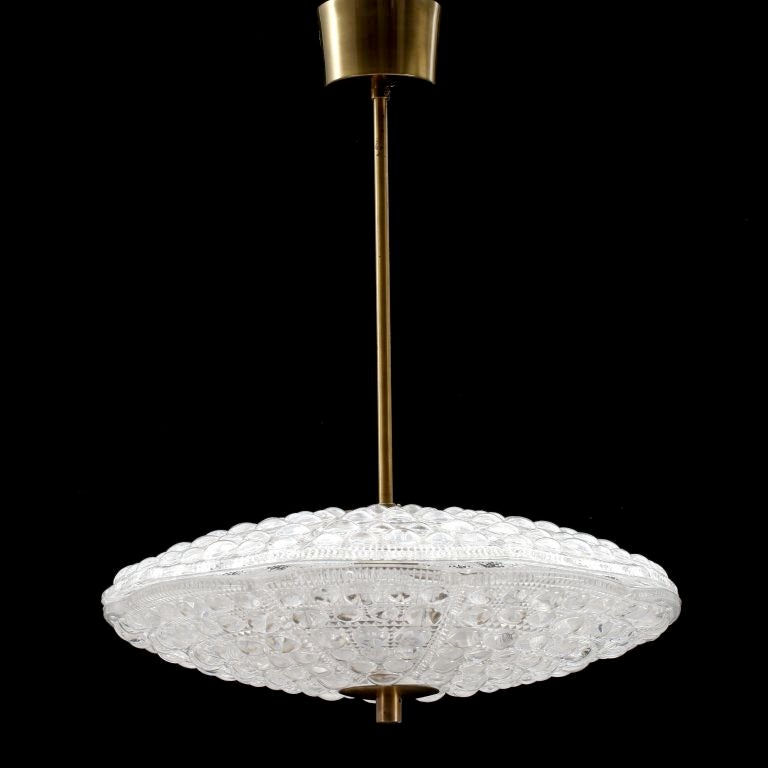 Flying Saucer shaped pendant in Orrefors crystal with brass fittings designed by Carl Fagerlund.