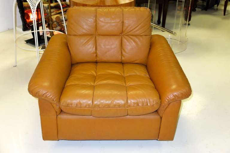 Gorgeous caramel colored soft leather lounge chair. Square tufted loose cushions with whip-stitching on the arm pads.  See our separate listing LU88661084338 for companion DeSede lounge chair with ottoman.
