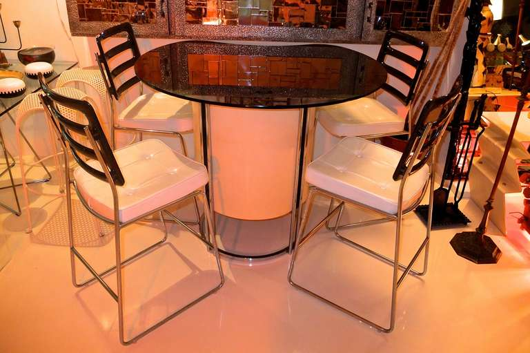 Vintage 1970's standing bar and four high chair bar stools by Chromcraft.