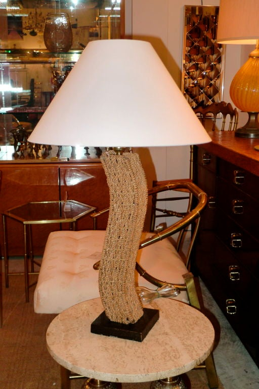 Sinuous and sculptural table lamps made of woven rope, attributed to French designers Adrien Audoux and Frida Minet.