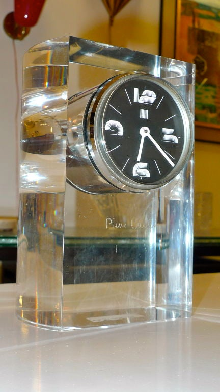 Produced by ITALORA in the early 1970's this is a handsome and extremely hefty table or desk clock engraved with Pierre Cardin's signature. Keeps accurate time. Graphic Pierre Cardin logo on the reverse. Clockworks Made in Italy.
