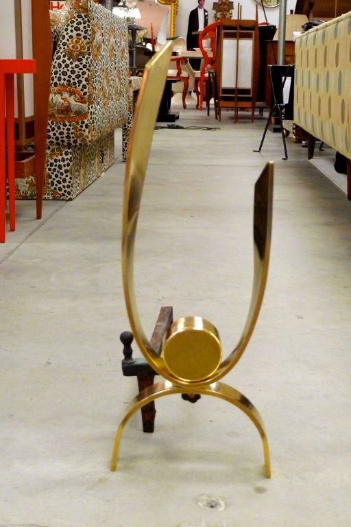 Wonderful pair of curvaceous brass ribbon-like andirons attributed to Donald Deskey