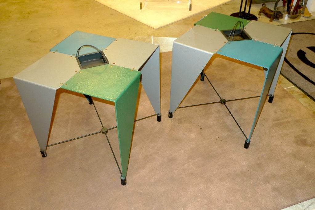 Whimsical pair of vintage side tables marked 'errebi' consisting of four geometric cut shapes of powder coated plate aluminum in grey, green and blue with a shallow jardiniere.  The design reminds me of the guerilla art project by Martino Gamper