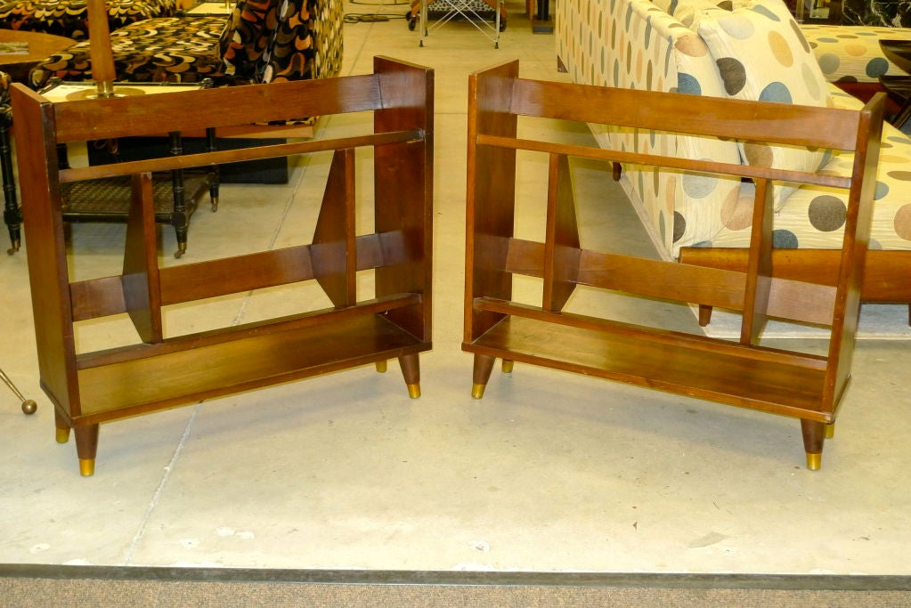 Pair of small walnut open book shelves clearly executed by a fan of Gio Ponti, with its asymmetrical structure and half-harlequin motif.  Tapered legs with brass capped feet.  Ideal book size is a National Geographic or Reader's Digest....also