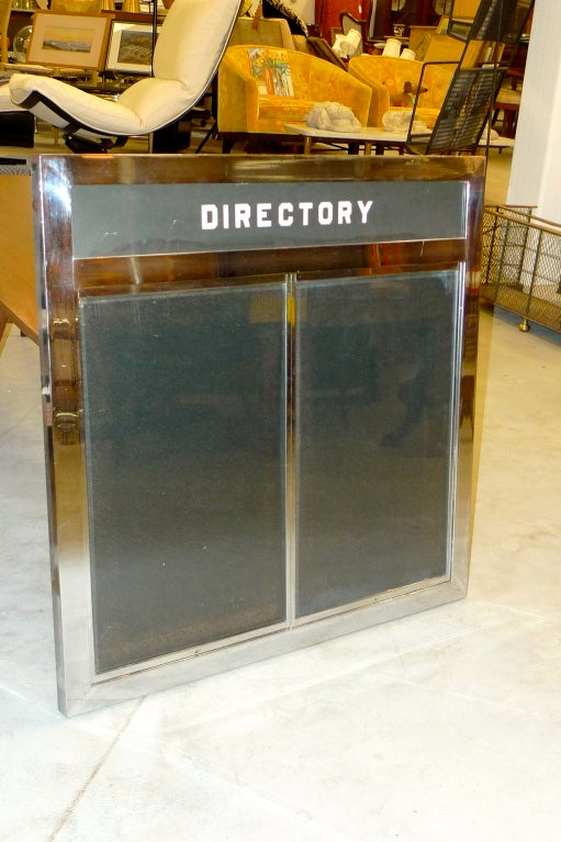 This is a very heavy chrome plated steel framed directory sign with beveled glass double panels.<br /> <br /> This came from the famous Boston (North End) restaurant 'Joe Tecce's' which recently closed after nearly 50 years.<br /> <br /> This