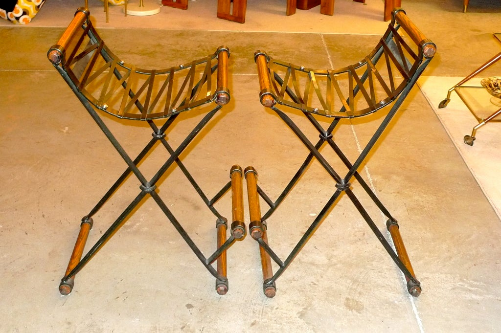 Pair of bar stools designed by Cleo Baldon in enameled metal and polished oak.