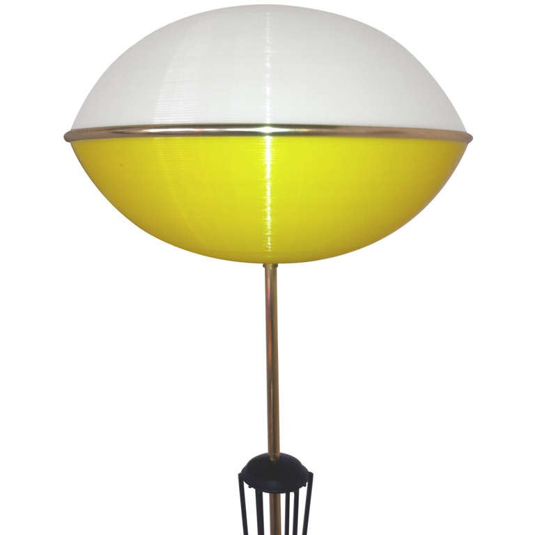 What a presence!  Majestic 1950's French floor lamp consisting of a stalk of black enameled brass tubing stretching upwards nearly 5 feet to a long brass skinny neck and an amusing extra-terrestial-like brain made of yellow and white ribbed perspex.