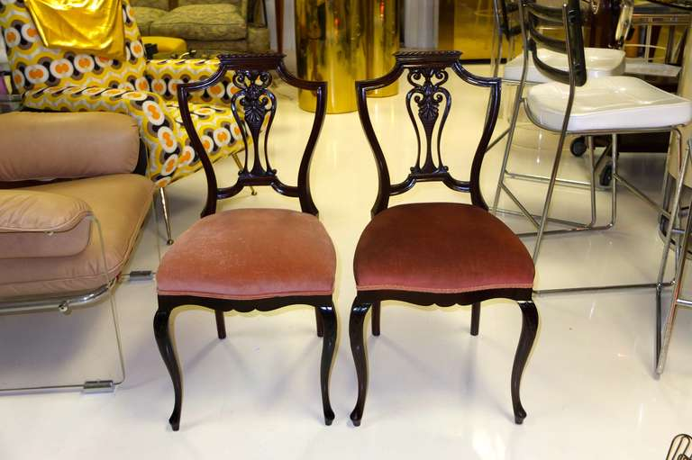 Pair of lovely little carved mahogany shield-back salon chairs with elements of both Georgian and Queen Ann styles.    Very sweet and charming.  Perfect extra seating when entertaining or for use with a ladies writing table.