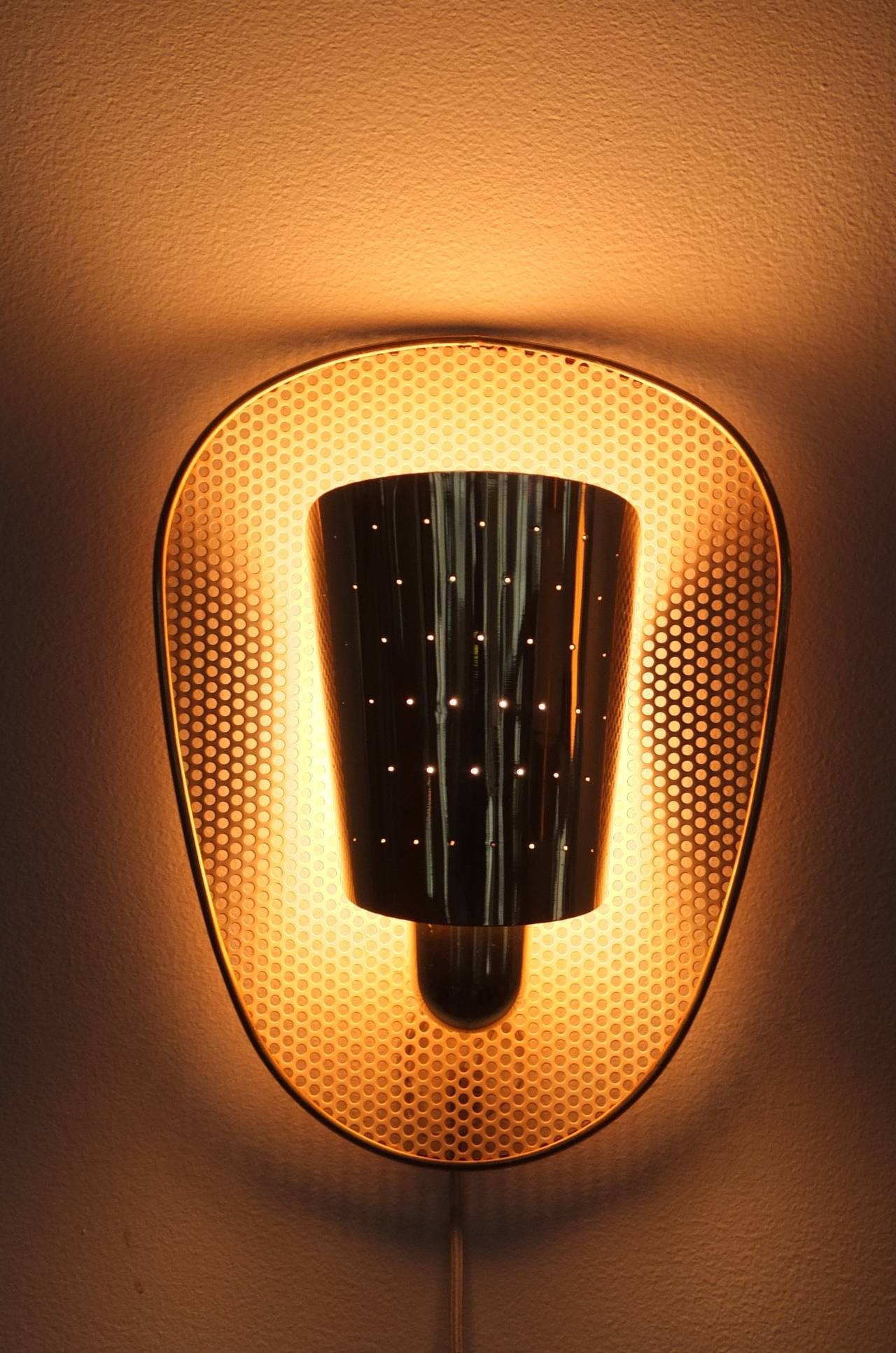 Pair of Brass and Perforated Metal Sconces by Jacques Biny at 1stdibs