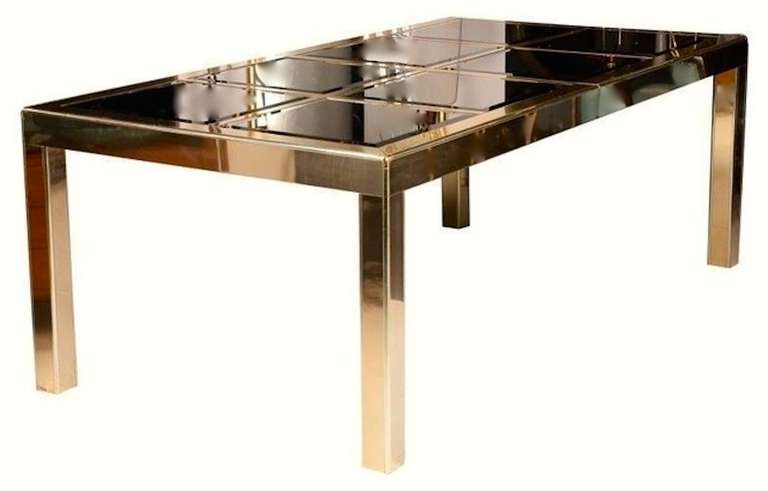 Brass framed parsons shape dining table by Mastercraft of Grand Rapids. The top of the table is an open grid into which inserts 8 square shaped mirror panels which are beveled and are tinted a metallic bronze giving this table a shimmering elegance