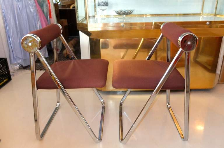 Stylish pair of 1970's Italian modern chromed folding chairs with rolled tubular backrest.  Attributed to Giancarlo Piretti.