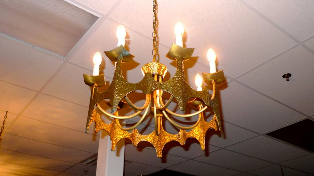 Brutalist hammered brass chandelier by MOE Lighting using batwing / stalagmite motif in the manner of Paul Evans and Oscar Neimeier's designs for Brasilia.<br />