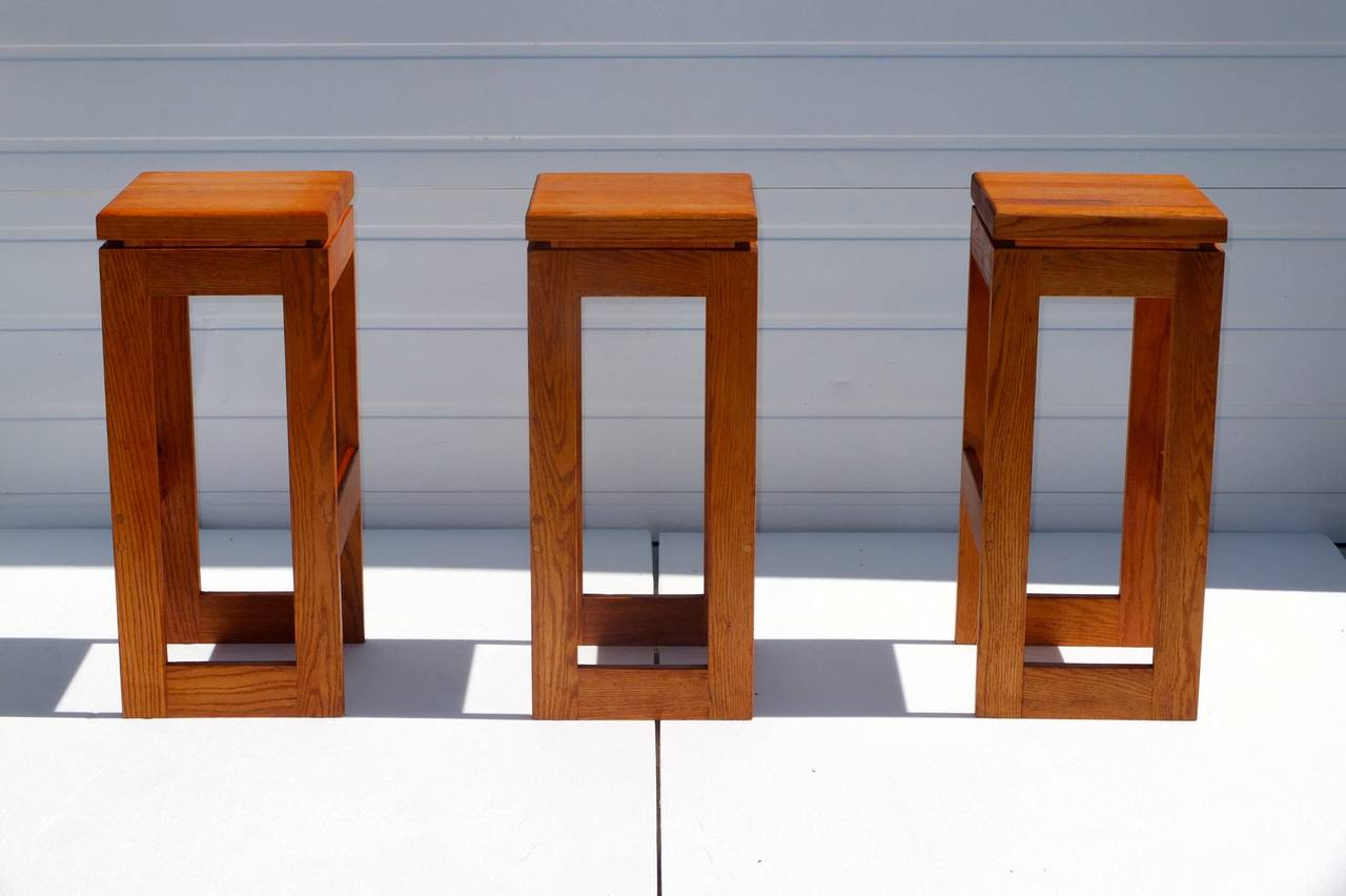 Set of six vintage solid butcher block bar stools custom made by Heinrich Savelberg of Woodstock, VT circa 1977.    Brand mark under each seat reads