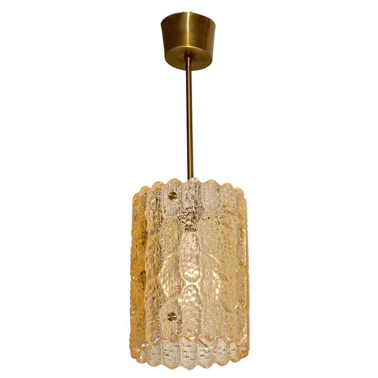 A Swedish crystal pendant light with brass hardware by Carl Fagerlund for Orrefors, Sweden.  Late 1940's - early 1950's.  The glass in this particular example happens to have a golden amber tint as opposed to clear.  Total height including