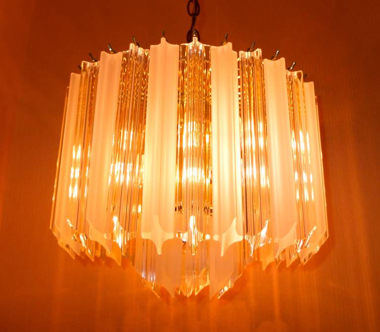 Mid-20th Century Pair of Hollywood Regency Lucite Triedri Prism Crystal Chandeliers For Sale