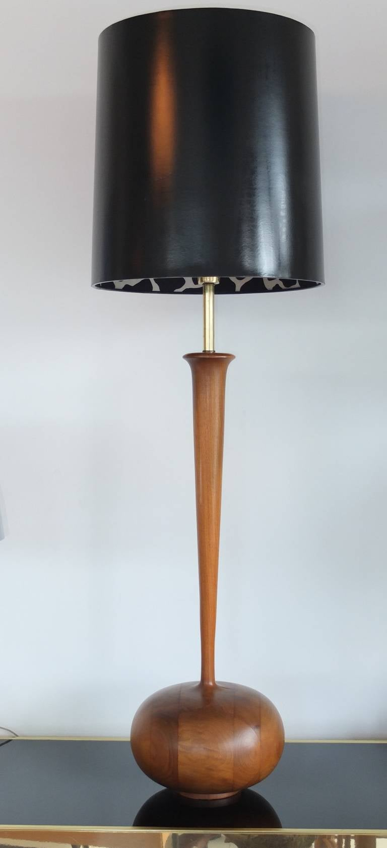 A mid-century modern studio craft solid walnut table lamp with bulbous base on a small foot, long organically tapering neck sprouting from the onion-like base, very nice brass socket and harp.