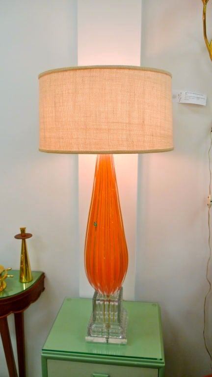 Designed and hand blown by Alfredo Barbini for Balboa, this lamp is a knock out! The tangerine colored heavily ribbed glass is vintage early 1950's with the original Balboa label still attached.  This lamp has been completely rebuilt using the