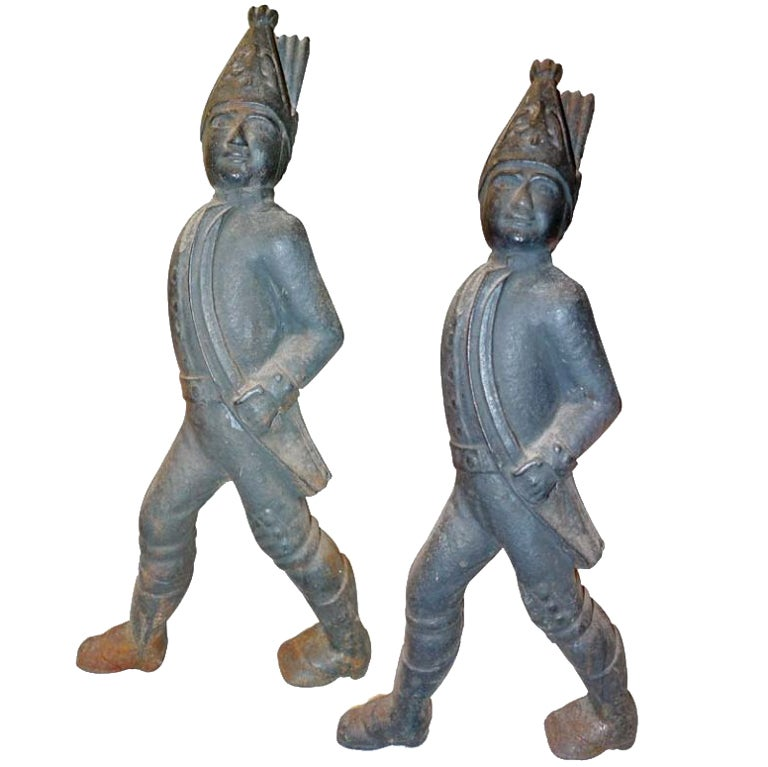 For Sale on 1stdibs - Pair of cast iron fireplace andirons in the form of Hessian soldiers. The Hessians were German mercenary soldiers hired by the British Crown to fight