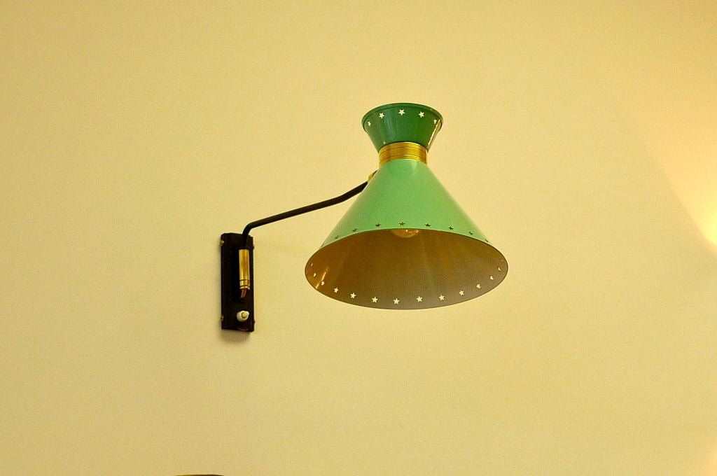 Similar to the Diabolo by Pierre Guariche this original French 1950's articulating wall light has its original green enameled reflector and is rewired.
