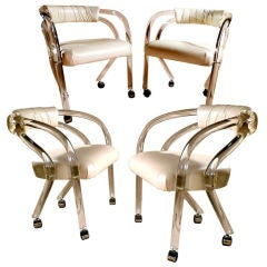 Set of 4 Lucite Chairs on Casters
