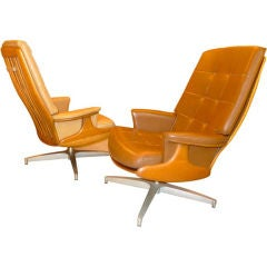 Pair of Heywood Wakefield Swivel Lounge Chairs
