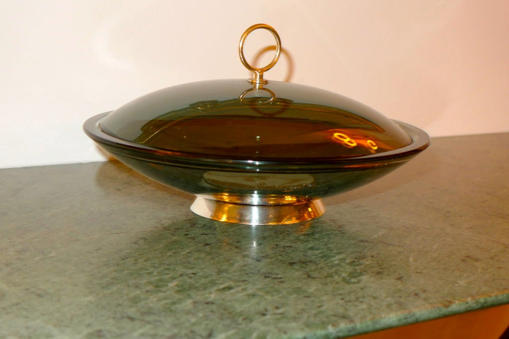 A 1960's smoked gray crystal covered bowl with chrome base and ring finial by Max Ingrand for Fontana Arte (Model #2004).   Original foil label on lid.