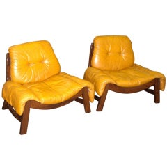in the St of Percival Lafer Pair of Tropical wood and leather Armchairs